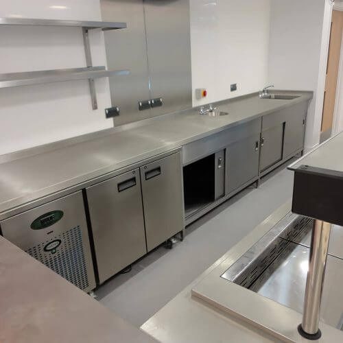 Stainless steel tabling, shelves and walls