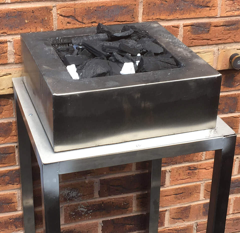 Stainless steel charcoal grill for barbecues